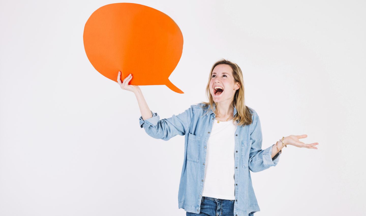 A lady holding an orange speech bubble to communicate policies and procedures