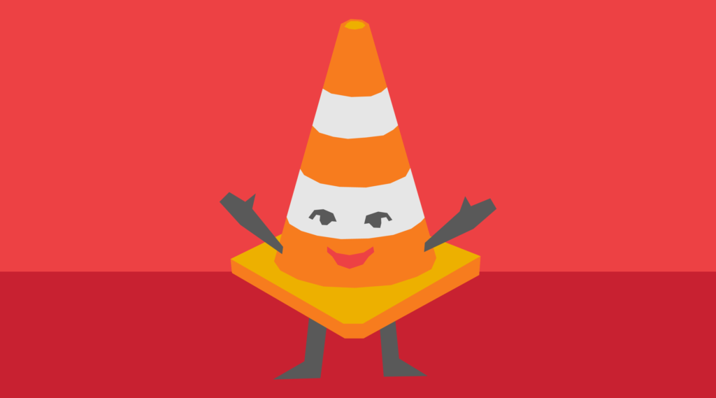Traffic cone with a smiling face on and arms and legs
