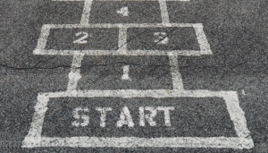 Chalk hopscotch which says start to represent the preboarding app